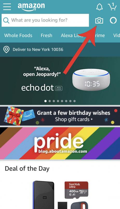 Foto da tela do site. Clique ali no ícone da câmera no aplicativo da Amazon pra escanear o código de barras